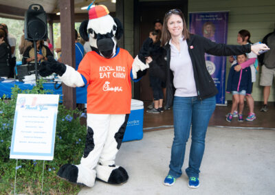 Chick-fil-a Cow and Young Woman Posing for a Picture