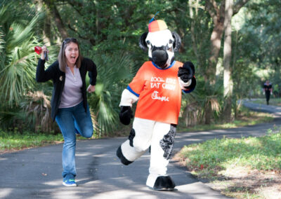 Woman and the Chick-fil-a Cow Staging their Running Motion